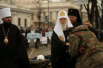 Euromaidan activist kisses the hand of Filaret the Patriarch of Kyiv